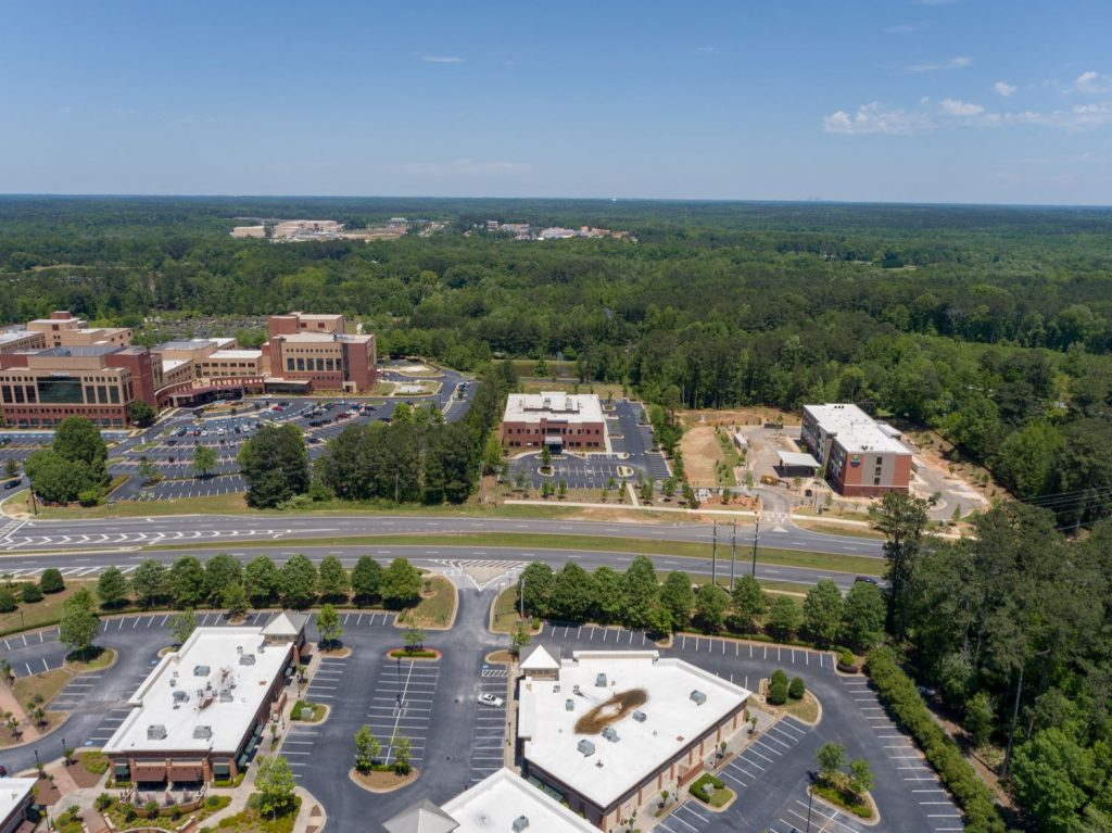 Aerial view of 1233 Highway 54 medical office building next to Piedmont Fayette Hospital in Fayetteville, GA.