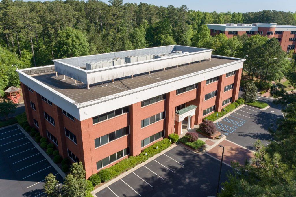 Aerial side view of 500 Westpark Drive office building in Westpark Commercial Center in Peachtree City, GA.