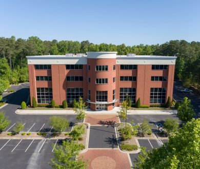Aerial front view of 525 Westpark Drive office building in Westpark Commercial Center in Peachtree City, GA.