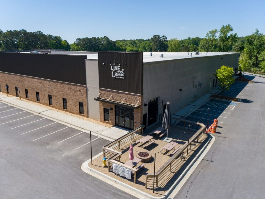 Aerial front view of Line Creek Brewing Co in Paschall Business Center in Peachtree City, GA.