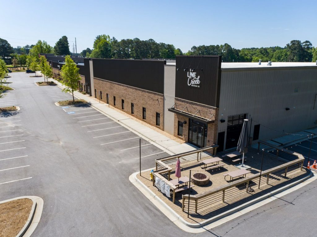 Aerial side view of Line Creek Brewing Co in Paschall Business Center in Peachtree City, GA.