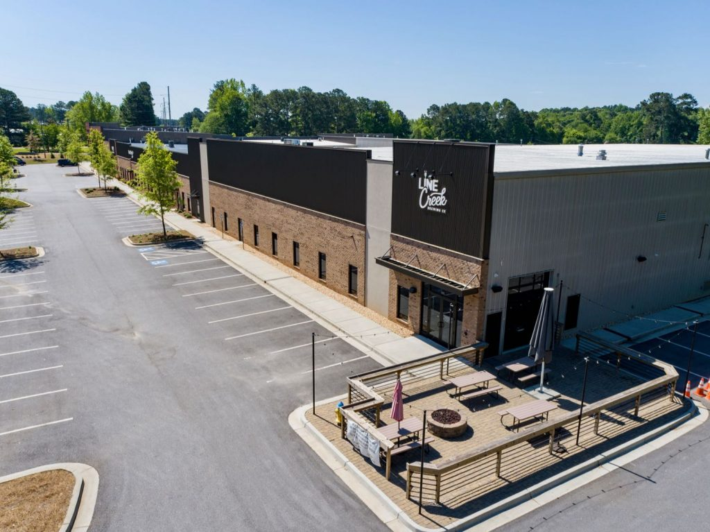 Aerial exterior view of Line Creek Brewing Company in Paschall Business Center in Peachtree City, GA.