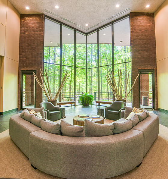 Interior lobby of 200 Westpark Drive with outdoor view in Peachtree City, GA.