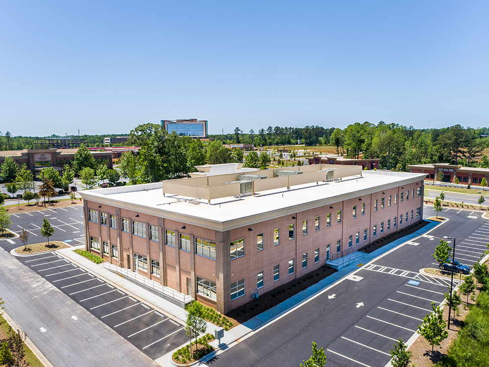 Aerial view of 2201 Newnan Crossing Blvd medical office building with Piedmont Newnan Hospital in the background.