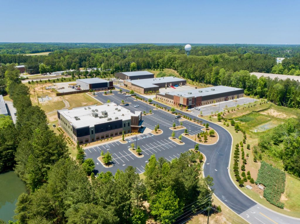 Aerial view of five buildings in the South 74 Industrial Office complex in Peachtree City, GA.