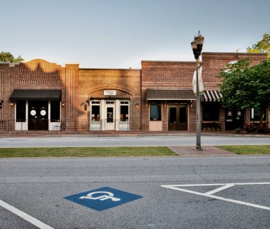 Front view of brick retail building on Main Street in historic Senoia, GA.
