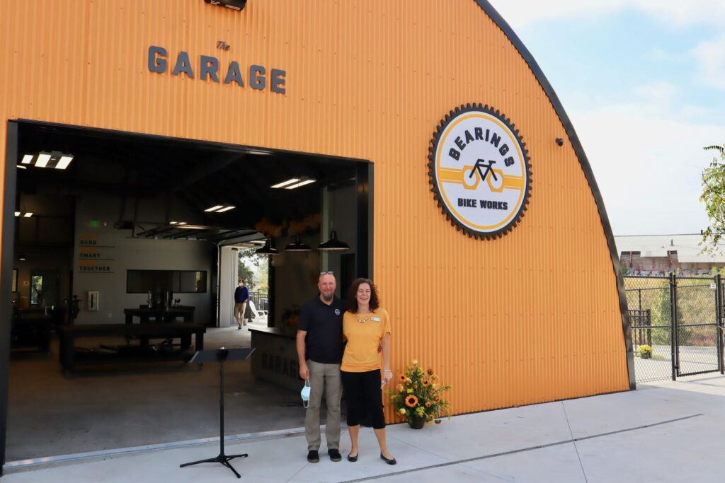 Bearings Bike Works, Tim and Becky O'Mara in front of The Garage.