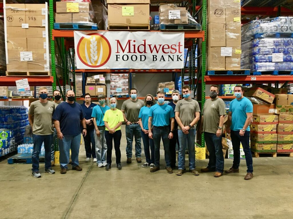 Southtree Commercial Construction Team volunteering at Midwest Food Bank in Peachtree City GA.