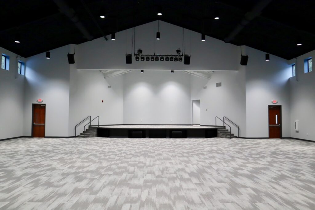 Sanctuary and stage in New Beginnings South Metro Community Center in Fayetteville, GA.
